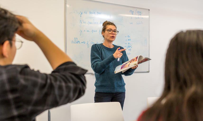 French Tutor teaching in classroom